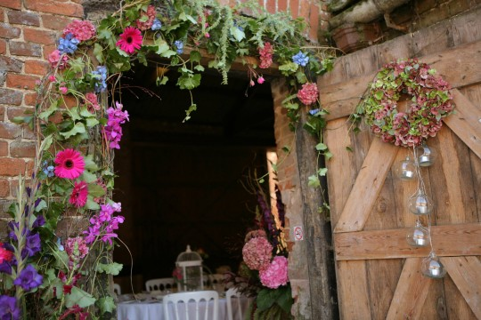 Beautiful flowers around the entrance to the barn